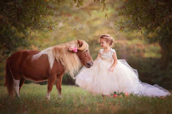 Retratos de niños con animales vivos: consejos para una sesión de fotos mágica